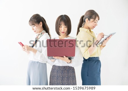 Group of asian woman using digital devices. #1539675989