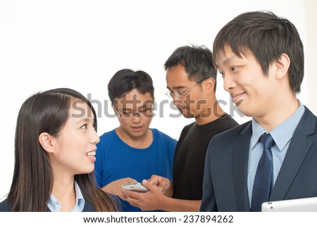 Group of asian workers discussing about new projects with tablet and smartphone. Isolated on white. #237894262