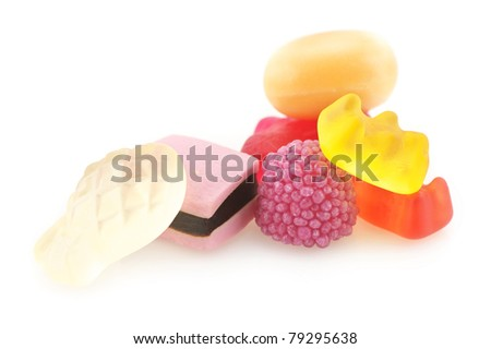 Group of assorted colorful candy isolated on white background.