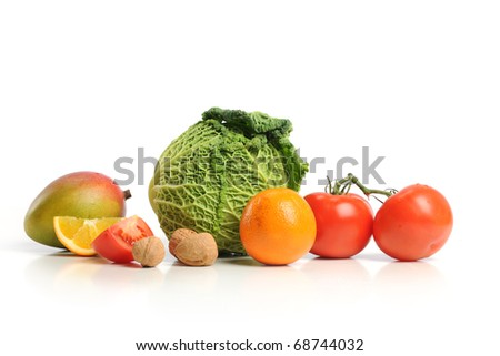 Group of assorted fruits and vegetables isolated o a white background
