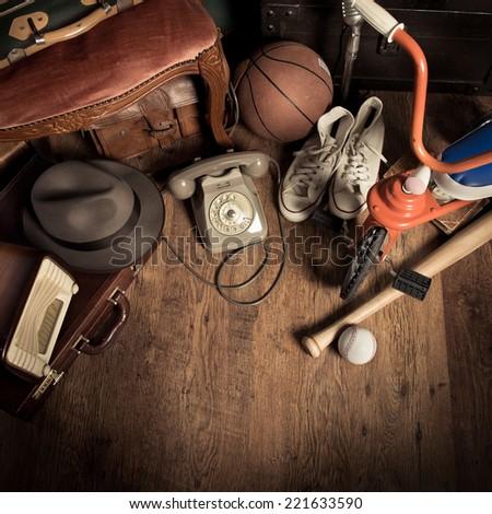Group of assorted vintage items on hardwood floor at flea market. #221633590