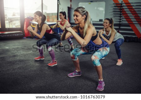 Group of athlete women exercising at the gym. Fitness women exercising at gym. #1016763079