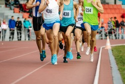 group of athletes runners middle distance running of competition in athletics