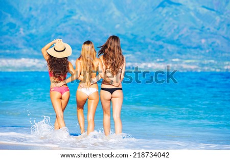 Group of Attractive Girls in Sexy Bikinis Having Fun Walking on Tropical Beach