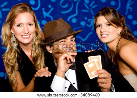 Group of attractive poker players smiling, blue background