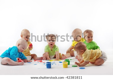 Group of babies painting