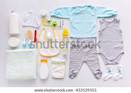 Group of baby boy clothes and equipment. Top view.