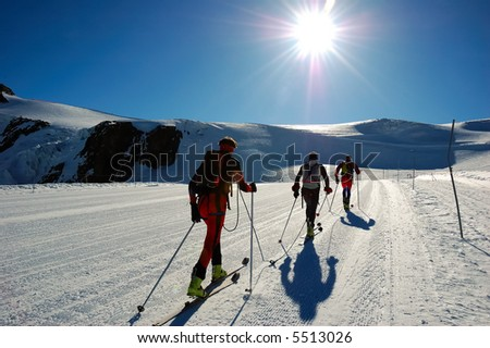 Group of backcountry skiers (ski touring), west alps, Europe.