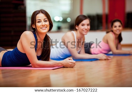 Stock Photo Group of beautiful female friends taking a break from their gym class and smiling