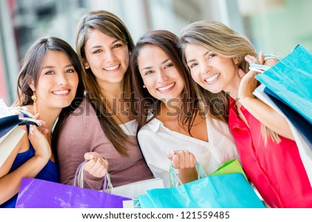 Group of beautiful female shoppers looking very happy