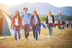 Group of beautiful teens arriving at summer festival