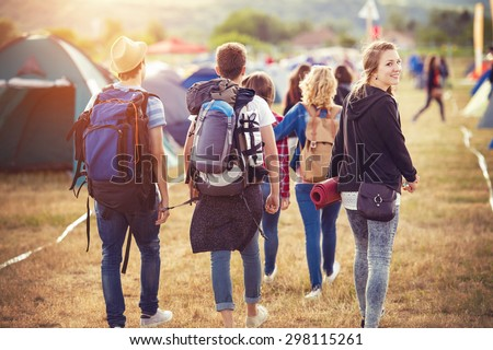 Group of beautiful teens arriving at summer festival #298115261