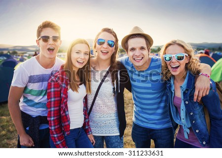 Shutterstock Group of beautiful teens at summer festival. Young teens at summer music festival. Funny group of young girls and boys at music festival. Happy teen at summer festival.