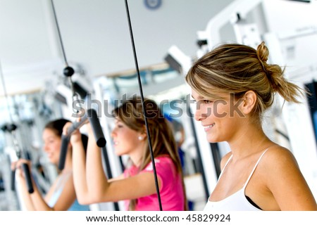 Group of beautiful women at the gym exercising - stock photo