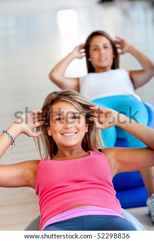 Group of beautiful women in a pilates class at the gym