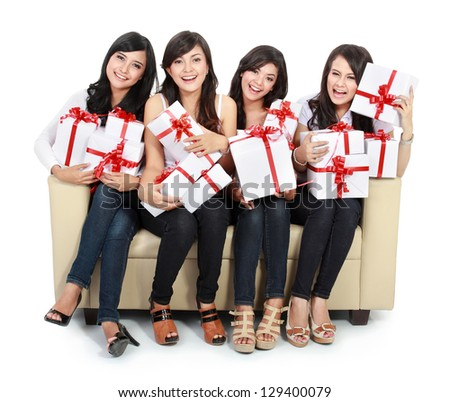 group of Beautiful young woman with many gift boxes sitting on the sofa