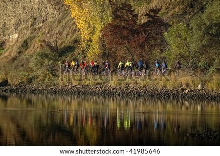Group Of Bicylists Along American River Folsom California