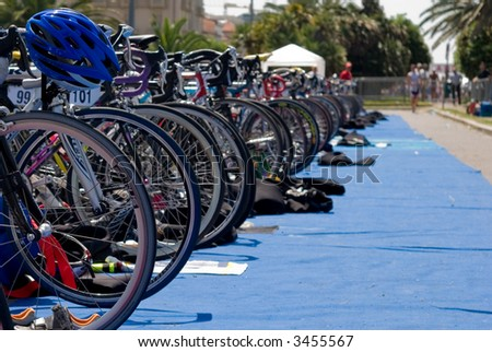 Group of Bikes\' wheels in a row  in a triathlon competition.