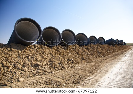 group of black big pipelines at the country in Spain