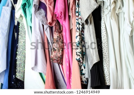 Group of blouses hung for a long time, with dust, in the closet.
