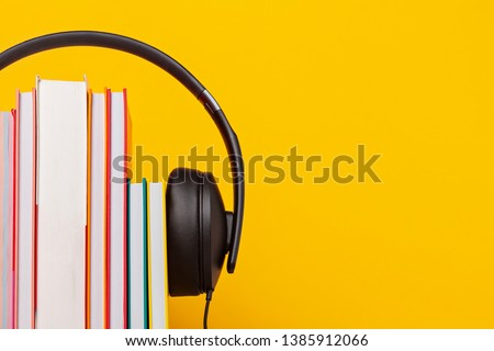 Group of books with the earphones. Audiobooks. Listen and study concept. Stockfoto ©