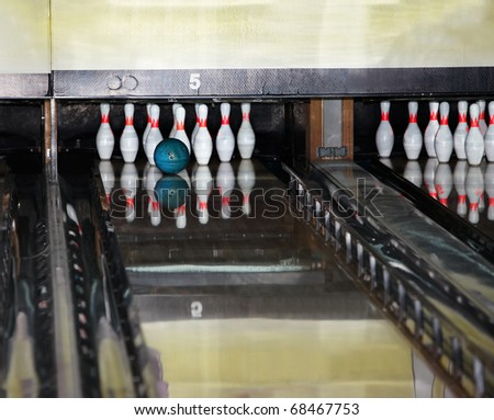Group of  bowling skittles and  ball. Still life.