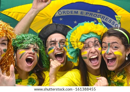 Group of Brazilian soccer fans commemorating victory.