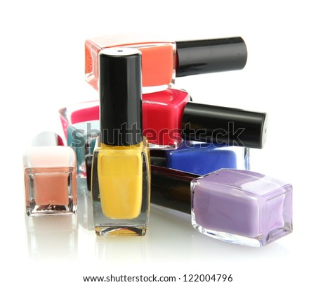 Group of bright nail polishes isolated on white