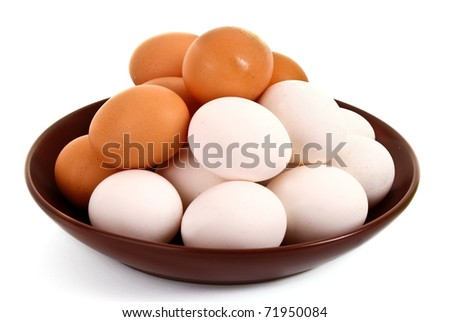 Group of brown and white hen's eggs in the plate isolated on white - stock photo