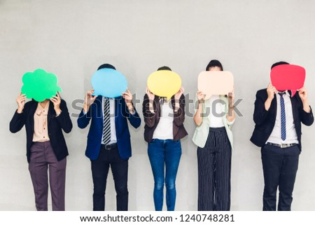 Group of business holding a speech bubble icon #1240748281