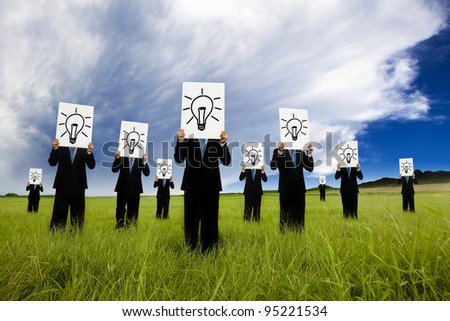group of business man holding bulb symbol. business idea and solution concept