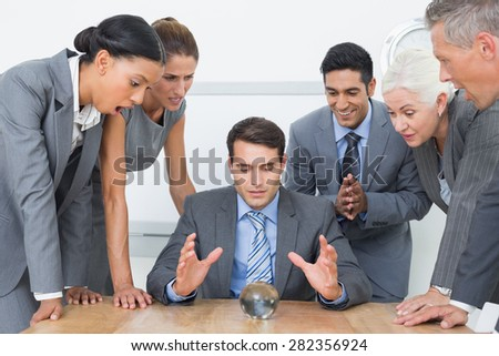 group of business man predict the future with a crystal ball #282356924