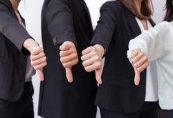 Group of Business man show dislike or unlike thumbs down hand