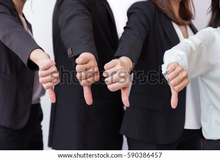 Group of Business man show dislike or unlike thumbs down hand  #590386457