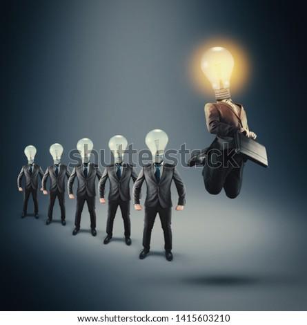 Group of business man with lightbulbs instead of head. Lit lightbulb businessman jumping.
