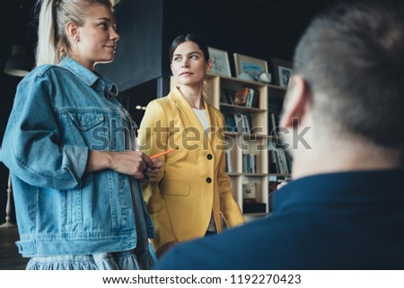 Group of business partners discussing new company strategy with boss #1192270423