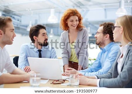 Group of business partners sharing ideas upon computer project at meeting #193500977