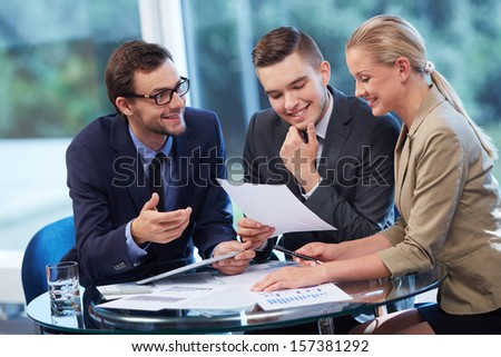 Group of business partners working with documents in office