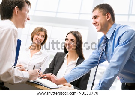 Group of business people analyzing and discussing during a working meeting