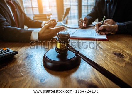 Group of business people and lawyers discussing contract papers ,Consultation between a male lawyer and businessman concept Stock photo ©