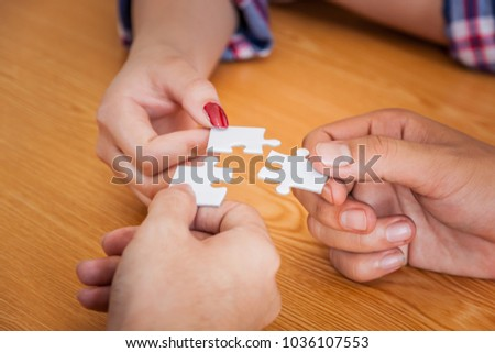 Group of business people assembling jigsaw puzzle and represent team support and help concept, Concept for teamwork Building a success. #1036107553