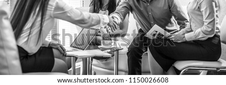 Group of business people at work black-white photo. Employers hands close-up. #1150026608