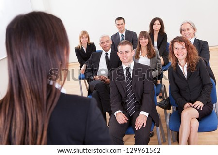 Group Of Business People Attending The Lecture