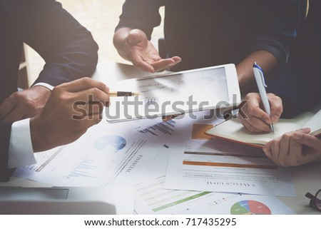 Group of business people busy discussing financial matter during meeting. Corporate Organization Meeting Concept