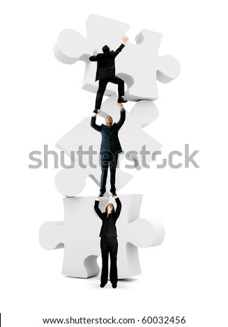 Group of business people climbing on the pieces of a puzzle - isolated