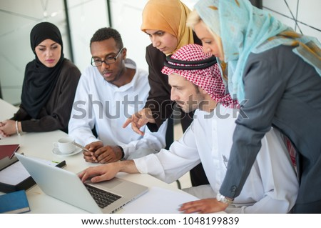 Group of business people discussing at meeting #1048199839