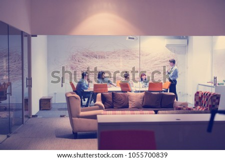 Group of business people discussing business plan  in the office #1055700839