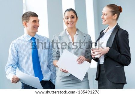 group of business people discussing documents in the office