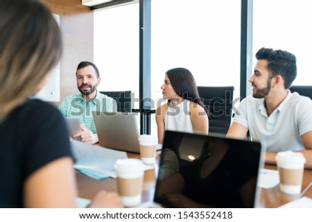 Group of business people discussing in meeting at creative office #1543552418