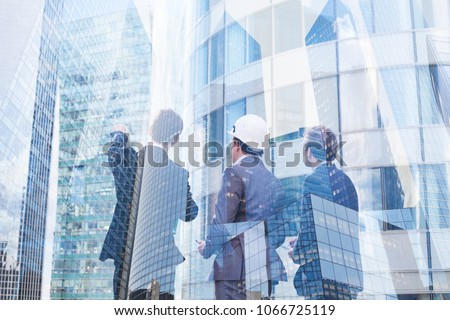 group of business people discussing real estate project, construction of new building, cooperation of architect, designer and manager stock photo